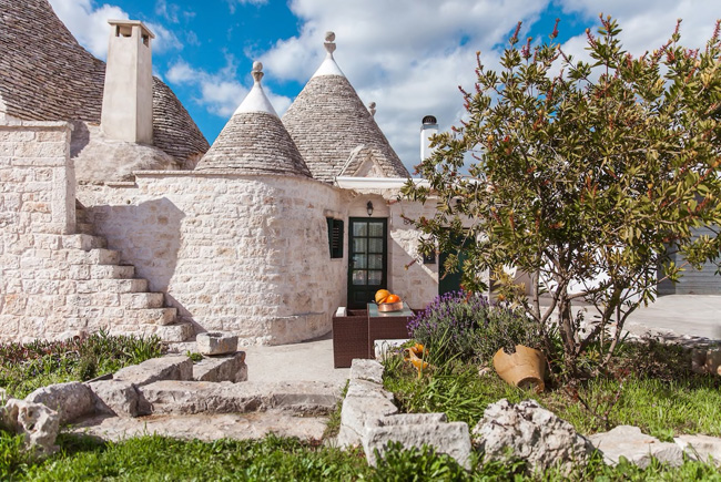 Trullo, traditional Apulian dry stone huts, of 1800 in the Itria Valley, Italy. © airbnb / Biagio